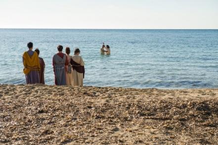 baptizes